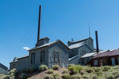 Mining and industrial buildings in a ghost town. Abandoned mine and industrial buildings at Bodie State Historic Park, California stock photography