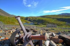 Abandoned mine. Old broken flywheel of an abandoned copper mine in the mountains royalty free stock images