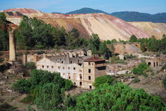 Abandoned mine with tower and ruins. Royalty Free Stock Photography