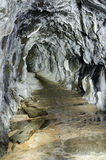 Abandoned mining adit with aragonite coatings. Old abandoned mine tunnel with aragonite coatings stock photography