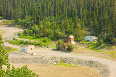An abandoned mining compound in northern canada. Buildings left by placer gold prospectors once finished mining their staked claim Royalty Free Stock Photo