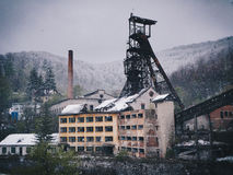 Abandoned mining facility in winter time (heavy snowing)  Royalty Free Stock Images