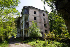Abandoned mining ghost-town Polyana, Abkhazia. Destroyed empty houses Stock Photography