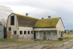 Abandoned mjölkar hus- och mejeriladugården Royaltyfria Foton