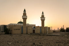 Abandoned Mosque in Abu Dhabi. A deserted Mosque in Abu Dhabi with modern buildings in the background Stock Images