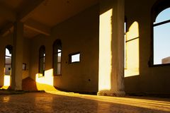 Abandoned Mosque. View of abandoned Mosque in the abandoned village in Sharjah, United Arab Emirates. The desert rightfully reclaims what actually belongs to it Stock Photo