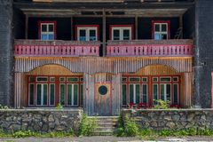 An abandoned motel made out of wood with red accents royalty free stock photo