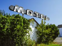 Abandoned motel and rustic sign. Photo of an old sign from an abandoned motel stock image