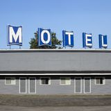 Abandoned motel on the side of the highway. Photo of an empty abandoned roadside motel on the side of a highway royalty free stock images