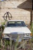 Abandoned Motor Vehicle. Launceston, Tasmania-February 2, 2012. Luxury model motor vehicle sits abandoned on a vacant block of land Stock Photos