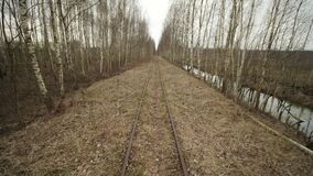 Abandoned narrow gauge railway in the forest, autumn day