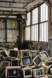 Abandoned National Acme - Cleveland, Ohio. A pile of computers inside the abandoned National Acme factory in Cleveland, Ohio stock photos