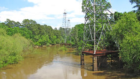 Abandoned oil derricks on the Sabine River Stock Images