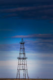 Abandoned Oil Rig Profiled On Cloudy Day Sky Stock Images