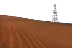 Abandoned oil rig and sand dunes in the desert stock photo
