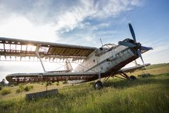 Abandoned old airplane on the field Stock Image