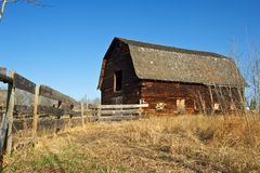 Abandoned old barn and wooden fence Royalty Free Stock Photo