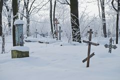 Abandoned old believer cemetery. In the snow stock images