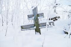 Abandoned old believer cemetery. In the snow royalty free stock photo