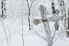 Abandoned old believer cemetery. In the snow stock photography