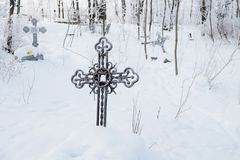 Abandoned old believer cemetery. In the snow stock image