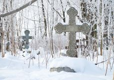 Abandoned old believer cemetery. In the snow royalty free stock photos