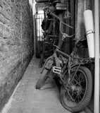 Abandoned old bicycle in grayscale Royalty Free Stock Image