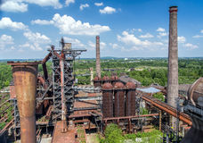 Abandoned old blast furnace at Duisburg, Germany. Old industrial buildings and chimneys of abandoned steel mill plant at Duisburg, Germany. Now Road of stock photos