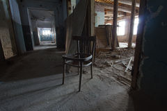Abandoned old building - broken dusty chair in corridor Royalty Free Stock Photography