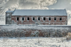 Abandoned old building. Abandoned old prison building cowered with snow Stock Photos