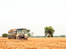 Abandoned old bus in a vacant field Old school bus in field with trees nobody vintage background royalty free stock image