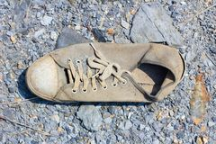 Abandoned old canvas shoes have damaged Royalty Free Stock Photos