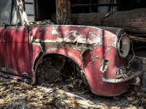 Abandoned old car body covered with rust Stock Photos