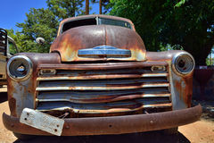 Abandoned old Chevrolet car. SOLITAIRE, NAMIBIA - JAN 30, 2016: Damaged abandoned old Chevrolet car at the service station at Solitaire in the Namib Desert Royalty Free Stock Image