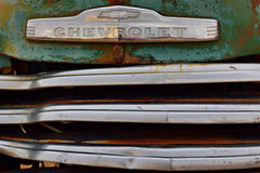 Abandoned old Chevrolet car. SOLITAIRE, NAMIBIA - JAN 30, 2016: Car grille of the abandoned old Chevrolet car at the service station at Solitaire in the Namib Stock Images