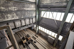 Abandoned old coal mine interior with empty carts Royalty Free Stock Photography