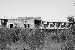 Abandoned construction site. Abandoned old construction site monochrome royalty free stock images
