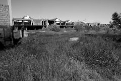 Abandoned construction site. Abandoned old construction site monochrome royalty free stock photography