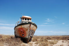 Abandoned. Old abandoned fishing boat in the desert of South Spain stock photo