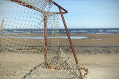 Abandoned old football goal on the sea beach on a sunny day, Jurmala, Latvia stock image