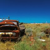 Abandoned old ford truck on farm by a factory stock image