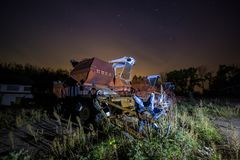 Abandoned old harvester at night royalty free stock photography