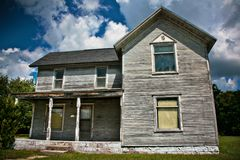 An abandoned old home. An old abandoned home with sky in the background stock image