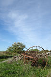 Abandoned old horse rake in a landscape at springtime Stock Images