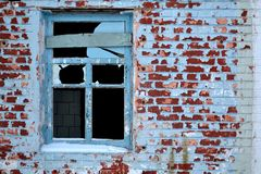 Abandoned old house. Aged brick walls. Broken window Stock Images