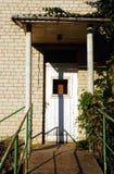 Abandoned  old house entrance. Abandoned grunge old house entrance with unkept climber plant Stock Image
