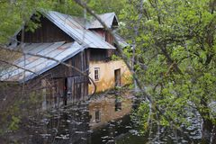 House on flood in Romania. Abandoned old house on flood in Romania royalty free stock image