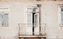 Abandoned Old House with Mosaic. An open door in a balcony Royalty Free Stock Photography