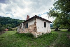 Abandoned old house in rural mountain landscape. Abandoned old house in rural mountain region Royalty Free Stock Image