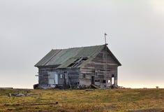Abandoned old hunting house in tundra of Novaya Zemlya archipelago Royalty Free Stock Photos